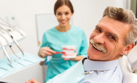 Senior man with dentist