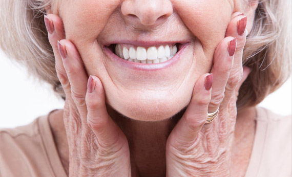 Old woman wearing dentures